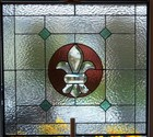 Stained Glass Fleur De Lis Panel at The Lawrenceville Inn, N.J. - This 23 x 25 panel features a beveled Fleur De Lis with clear,burgundy,iridescent and green rough rolled glass. This custom panel was created for a local French restaurant as privacy window.