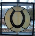 Horse shoe framed in stained glass - this is a 10 x 10 example of how we can mount your horse shoe in a stained glass piece.