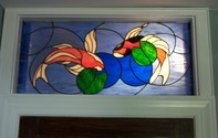 Koi Fish Transom Window Installed - This 31 x 15 piece was designed and installed in a bathroom transom window.