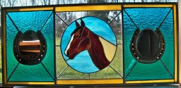 Custom horse shoe mirror - this project used a customers horse shoes and features a profile of their horse. it measures 30x 12