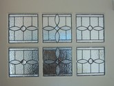 Antique Stye Front Door Inserts - These six 8 x 8 individual panels were designed using different types of textured clear glass and beveled jewels. They compliment the existing side light and transom windows.