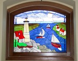 Harbor Scene - This 48 x 55 incredibly intricate piece almost looks like a painting. It was created for a new shore home as a privacy window using all opaque glasses. It was custom framed in mahogany.