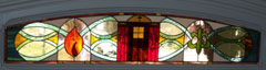 Transom window - St. John Vianney Church - St. John Vianney Church, Gladwyne Pa. Transom window. This 15 x 51 transom window was designed for the front door of the Vicar's house and symbolizes his sainthood