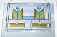 Twins - This 24 x 16 panel features beveled accent pieces,burgundy,amber,blue and green glass with a border of iridescent clear glass.