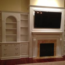 Office Cabinetry - A painted fireplace wall unit with space for TV, books, and storage.