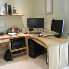 Elm Desk - Live edge Elm wrap around desk with 2 single board tops. Four sequential matched drawer fronts. Inlaid Wenge butterfly joints. Matching floating shelf from same tree.