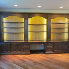 Maple library with cherry backs - Built-in library with lighting