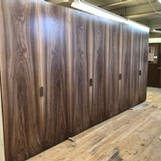 Bookmatched French Walnut Doors - Installed closets with French Walnut doors that are bookmatched