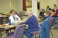 Members share ideas during break-out session